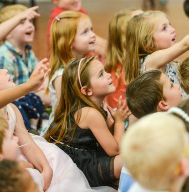 enrapt children at mr banana head birthday magic show