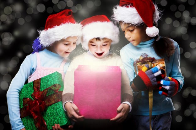 3 children holding Christmas presents