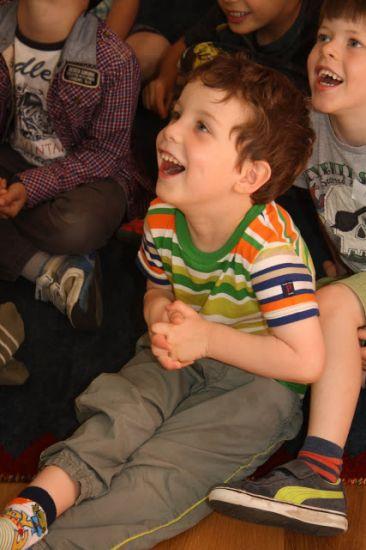 enrapt audience at a Mr Banana Head kids magic show