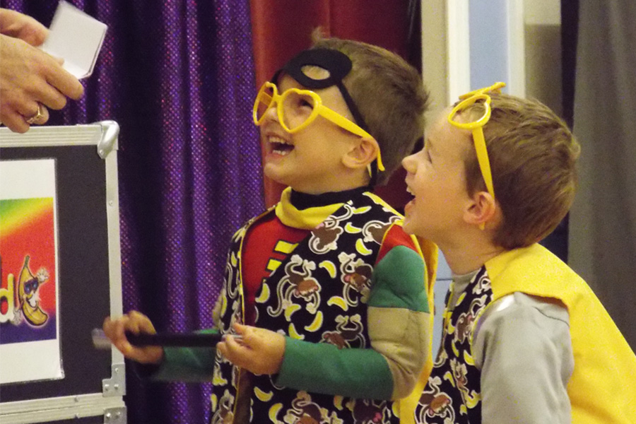 kids laughing at mr banana head magic show